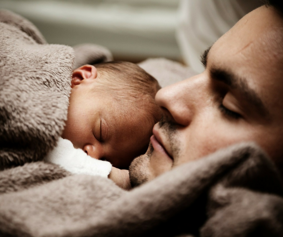 father and baby sleeping