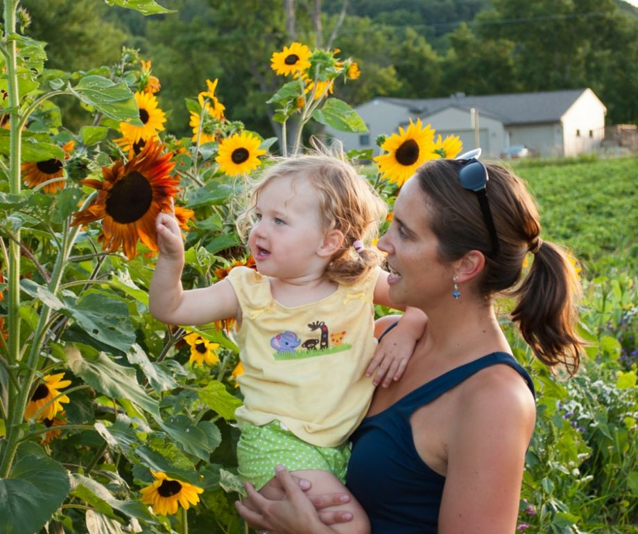 mother and daughter with sunflower