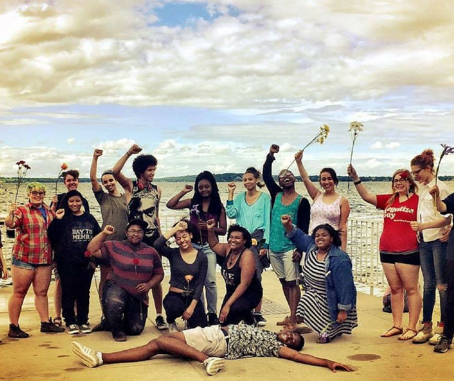 students celebrating on beach